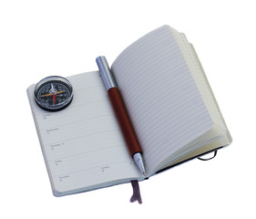 Open diary with a pen with compass, isolated over white