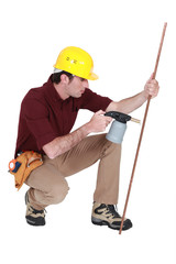 Tradesman using a blowtorch