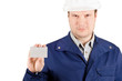 Portrait of young engineer holding a card