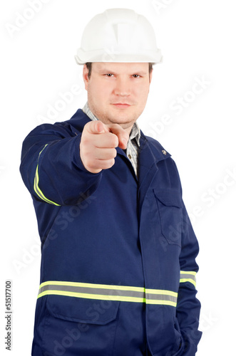 Portrait of young engineer pointing to the camera
