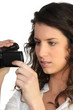 Woman holding a camcorder