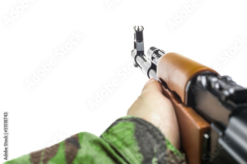 Soldiers hand with rifle AK-47
