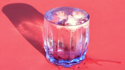 Glass of cold water with ice cubes in it