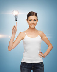 woman pointing her finger at light bulb