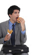 Businessman eating food