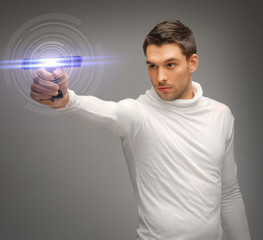 man with sci fi weapon