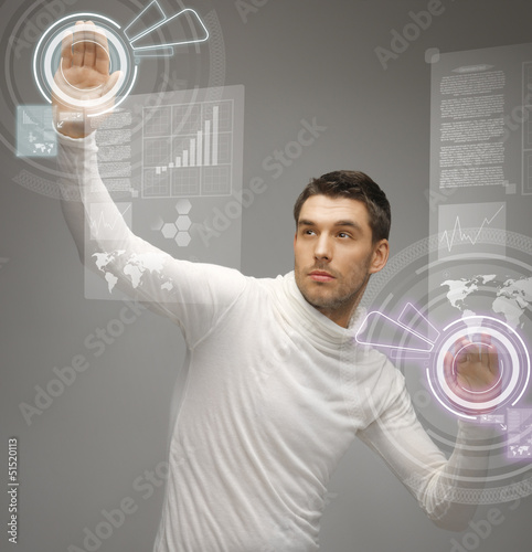 man working with virtual screens