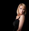 woman in black dress  over dark background