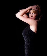 woman in black dress  over dark background