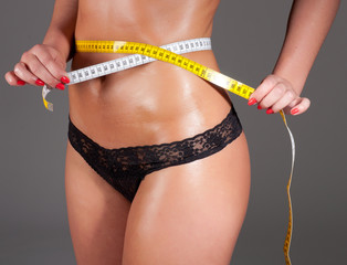 woman measuring perfect shape of beautiful thigh healthy.