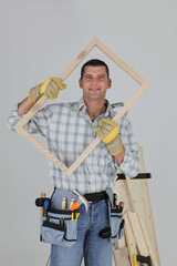 woodworker holding a window frame