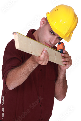 Carpenter measuring  wood