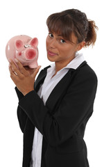 Businesswoman holding piggy-bank