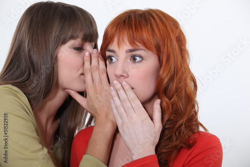 two young women gossiping