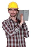 Builder with a concrete block