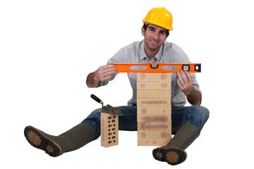 mason making a brick wall