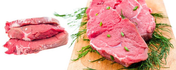 fresh and raw beef steaks in white background