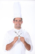 Chef with crossed cutlery