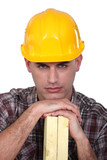 Construction worker with wood