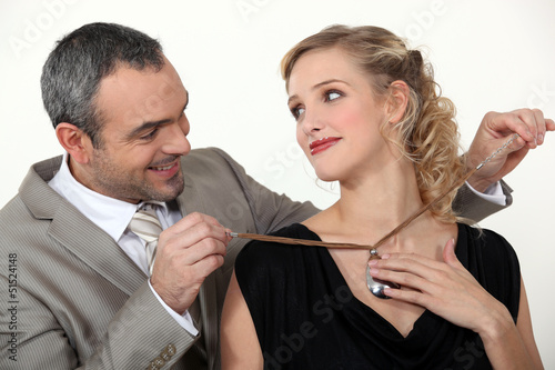 Man offering his wife a gift