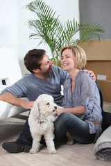 Couple and dog moving house