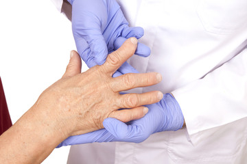 Senior woman with Rheumatoid arthritis visit a doctor