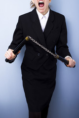 Angry businesswoman with nunchucks