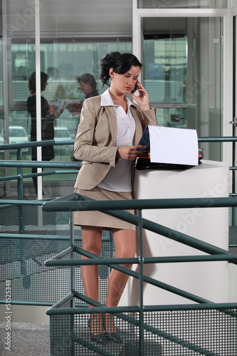 Businesswoman on the phone outside