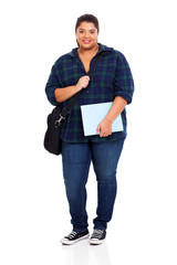 overweight university student holding text book