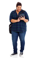 plus size college student with tablet computer