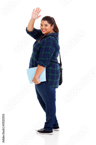 cheerful overweight student waving goodbye