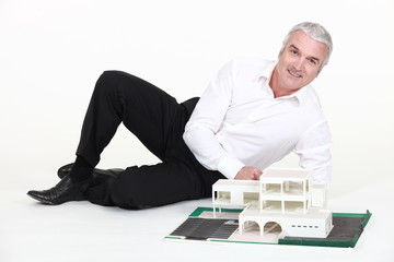 Architect with a scale model