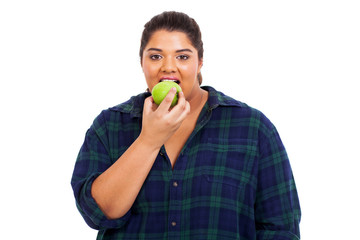 plus size young woman biting an apple