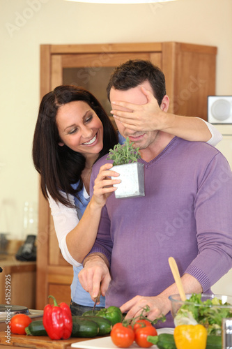 Couple preparing meal at home