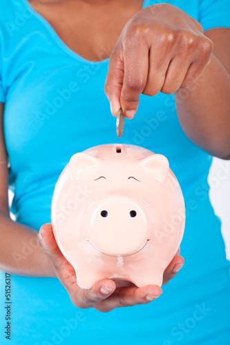 Black african american woman inseerting coin inside a smiling Pi