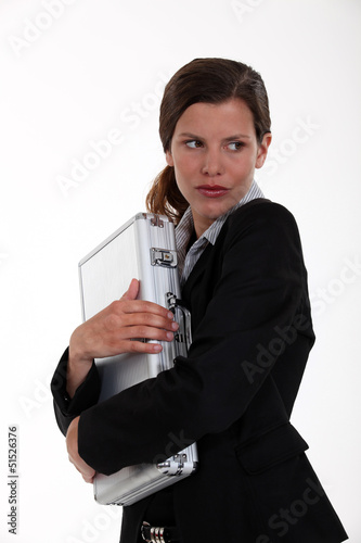 Woman very protective of metal briefcase
