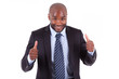 Black African American business man making thumbs up - African p