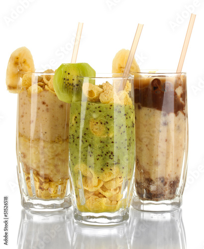 Delicious fruit smoothies isolated on white