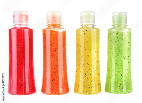 Bottles with scrub isolated on white