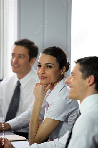 Woman participating in a business meeting