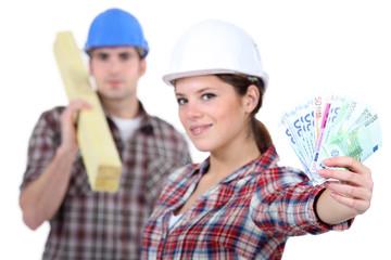 Two carpenters making money