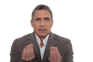 A mature businessman disagreeing.
