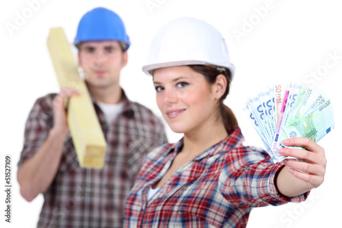 Two carpenters making money