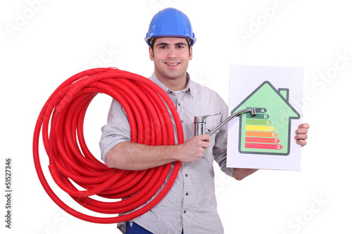 plumber holding a faucet and an energy consumption label