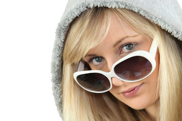 Blonde woman in large white sunglasses and a hooded fleece