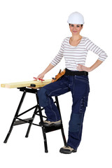 female carpenter and workbench isolated on white
