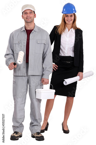 Tradesman and architect standing side by side