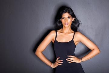 latin american fashion woman on black background