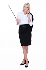 Businesswoman holding a conductor's baton
