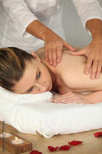 Woman receiving a back massage © auremar